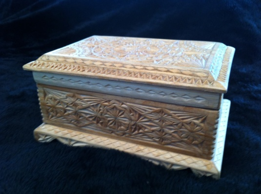 This is a gorgeous carved wooden box.  The picture doesn't do it justice.  You can't begin to see all the fine details!
