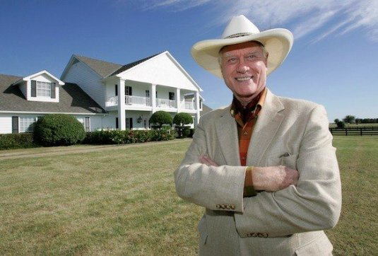 Larry Hagman as J.R. Ewing in front of South Fork (photo by Tony Gutierrez/ Associated Press)