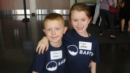 Kylee and Jackson have gotten their baptism t-shirt and are ready to go.