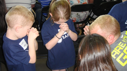 Families were asked to gather around and pray together before the baptisms.  Here Mike is praying with his three kids.