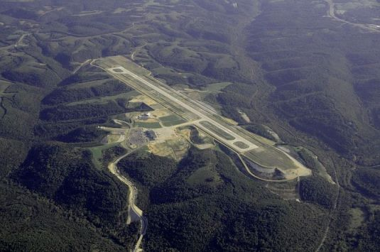 Aerial view of Branson Airport, LLC, snuggled among the beautiful Ozark Mountains (Picture from Wikipedia).