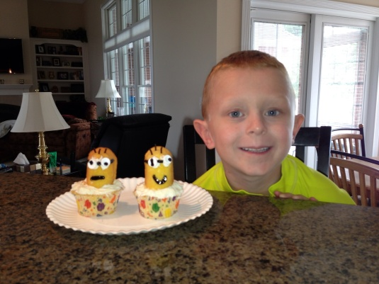 Minion cupcakes!  I had to help with the black eyes, goggles, and mouth.